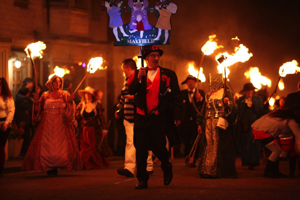 Photo of the Mayfield Bonfire Parade showing Mayfield Bonfire Society with their torches and costumes