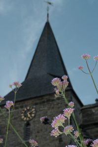 Flowers with St Dunstan's clock and spire behind