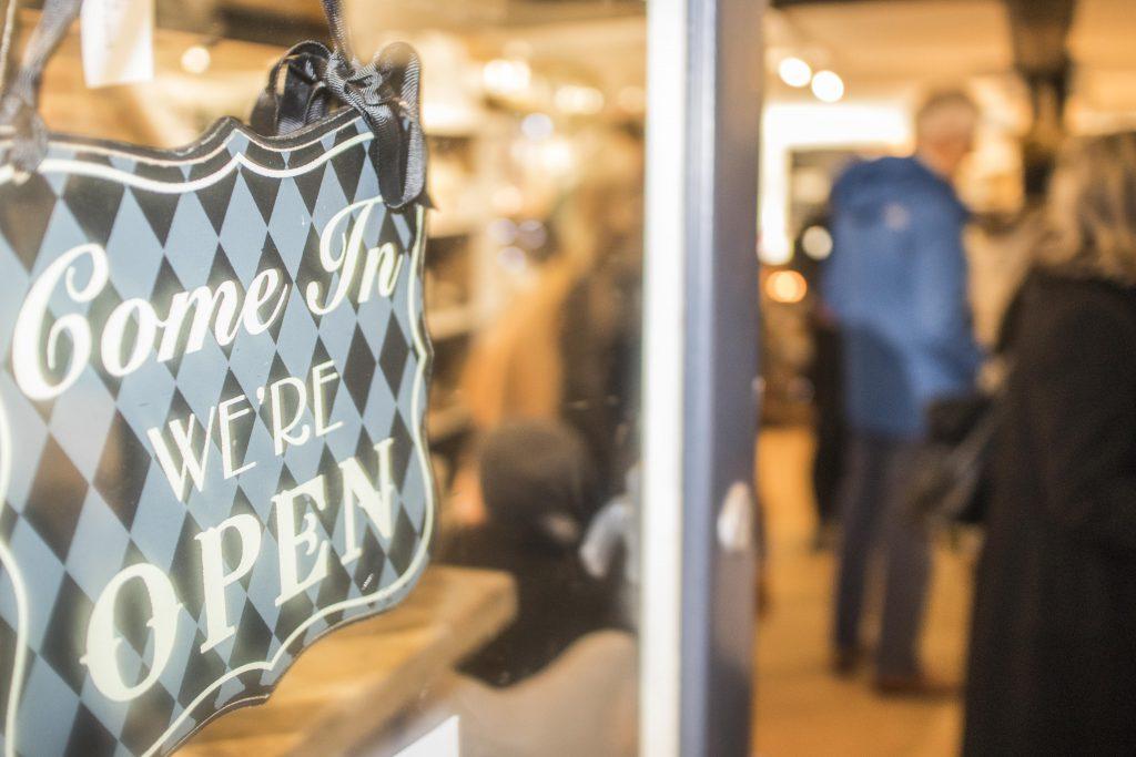 Come in - we're open sign on shop door