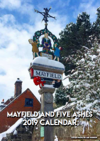 Photo of the Mayfield village sign in snow on cover of 2019 Mayfield and Five Ashes calendar